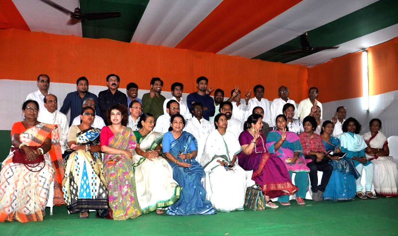 West Bengal Chief Minister and Trinamool Congress supremo Mamata Banerjee poses for a photograph with party's newly elected MPs in Kolkata on May 17, 2014.
