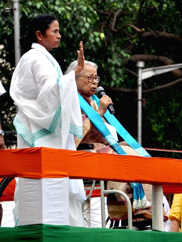 West Bengal Chief Minister and Trinamool Congress (TMC) supremo Mamata Banerjee with eminent writer Mahasweta Devi during Martyr's day (Shaheed Diwas) celebrations in Kolkata on July 21, 2014. ... - Mamata Banerjee