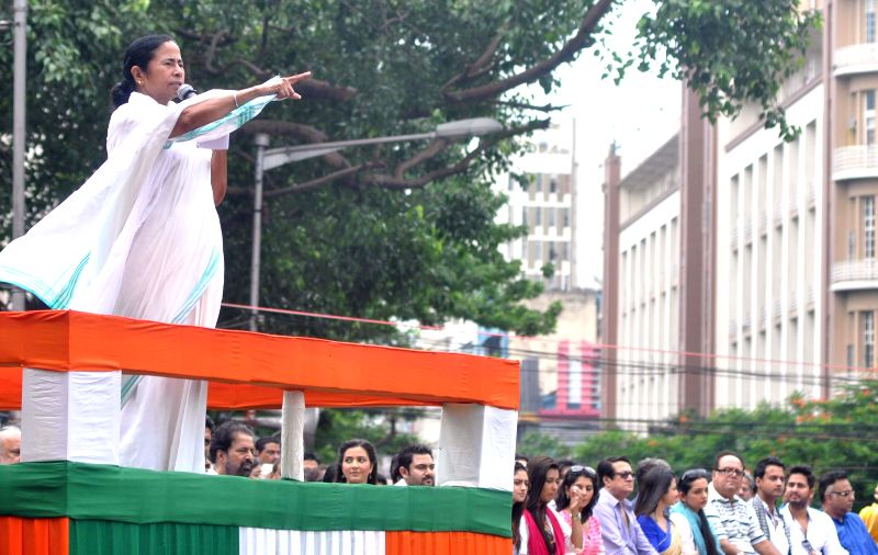 West Bengal Chief Minister and Trinamool Congress (TMC) supremo Mamata Banerjee addresses during Martyr's day (Shaheed Diwas) celebrations in Kolkata on July 21, 2014. Martyr's day is celebrated by .. - Mamata Banerjee