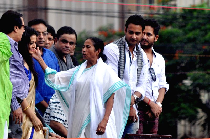 West Bengal Chief Minister and Trinamool Congress (TMC) supremo Mamata Banerjee with actors during Martyr's day (Shaheed Diwas) celebrations in Kolkata on July 21, 2014. Martyr's day is celebrated by - Mamata Banerjee