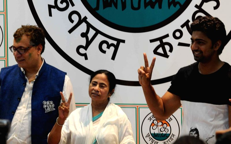 West Bengal Chief Minister and Trinamool Congress supremo Mamata Banerjee with party leaders Derek O'Brien and Dev during a press conference regarding party's performance in the recently ... - Mamata Banerjee