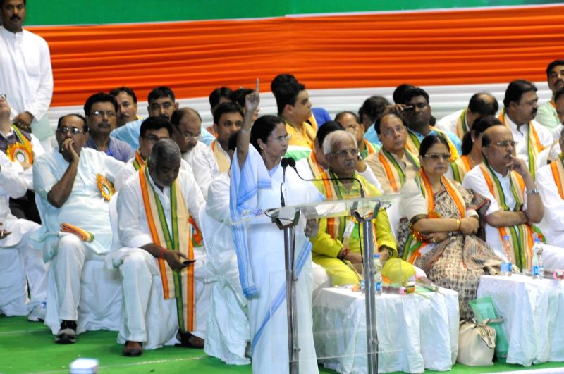 West Bengal Chief Minister and Trinamool Congress supremo Mamata Banerjee addresses during a party programme in Kolkata on April 21, 2017. Banerjee asked her party workers present at the ... - Mamata Banerjee
