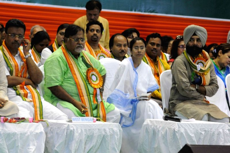 West Bengal Chief Minister and Trinamool Congress supremo Mamata Banerjee with party leader Partha Chatterjee during a party programme in Kolkata on April 21, 2017. Banerjee describing the ... - Mamata Banerjee and Partha Chatterjee