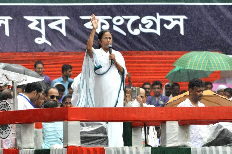West Bengal Chief Minister and Trinamool Congress (TMC) chief Mamata Banerjee addresses during her party's 25th Martyr's Day rally, in Kolkata on July 21, 2018.
