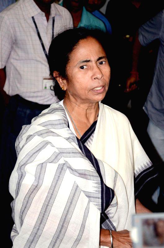 West Bengal Chief Minister Mamata Banerjee arrives at Netaji Subhash Chandra Bose Airport in Kolkata on July 19, 2014. Banerjee was on a North Bengal tour. - Mamata Banerjee