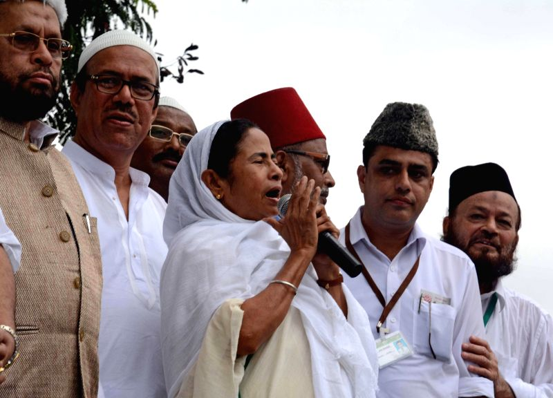 West Bengal Chief Minister Mamata Banerjee addressing Muslims after Eid-ul-Fitr prayers in Kolkata on July 29, 2014.