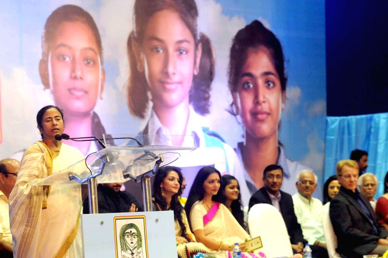 West Bengal Chief Minister Mamata Banerjee addresses during `Kanyashree`- a programme in Kolkata on Aug 14, 2014. - Mamata Banerjee