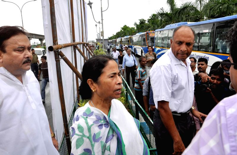 West Bengal Chief Minister Mamata Banerjee arrives to inaugurate new bus service which include a fleet of 4 air-conditioned and 33 non-air-conditioned buses at New Town in Kolkata on Sept 1, 2014. - Mamata Banerjee