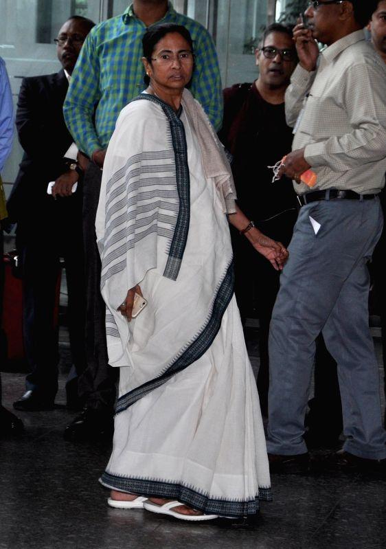 West Bengal Chief Minister Mamata Banerjee arrives at Netaji Subhas Chandra Bose International Airport to launch Durgapur-New Delhi direct flight in Kolkata, on Dec 7, 2015. - Mamata Banerjee