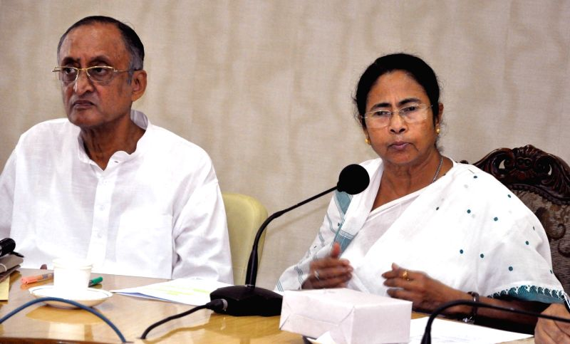 West Bengal Chief Minister Mamata Banerjee addresses a press conference at Nabanna in Howrah on July 19, 2016. Also seen West Bengal Finance minister Amit Mitra. - Mamata Banerjee