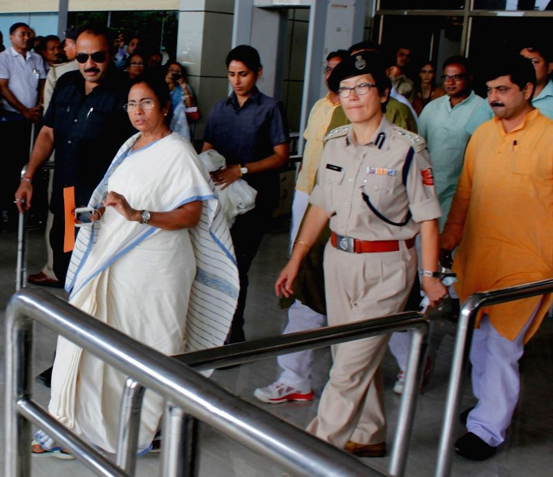 West Bengal Chief Minister Mamata Banerjee arrives at the Bagdogra Airport near Siliguri on Aug 22, 2016. - Mamata Banerjee
