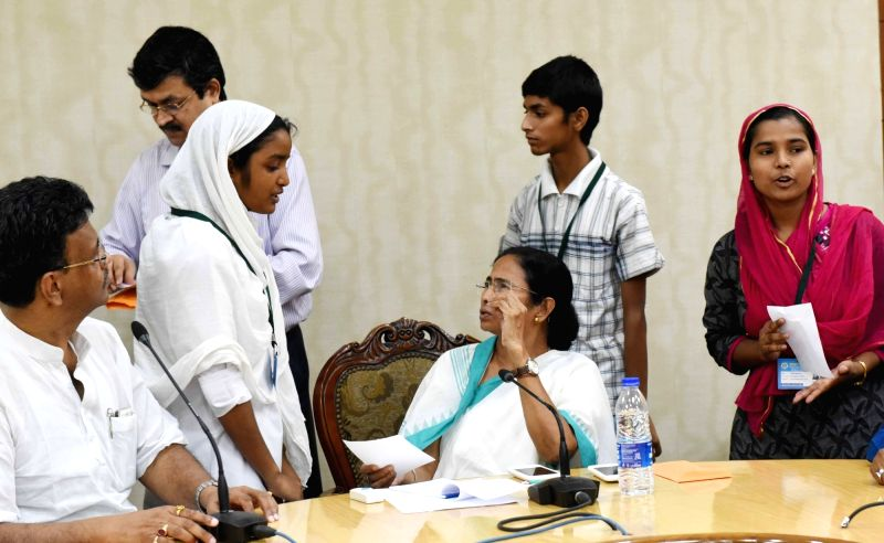 "West Bengal Chief Minister Mamata Banerjee felicitates Madrasa toppers at Nabanna in Howrah on June 14, 2017. (Photo"" IANS) - Mamata Banerjee"