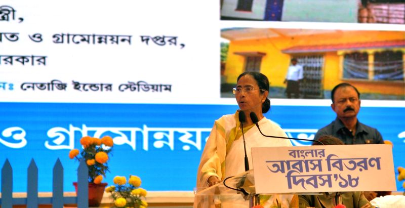"West Bengal Chief Minister Mamata Banerjee addresses during a programme organised to handover documents to the beneficiaries of ""Bengal Awas Yojana"" scheme in Kolkata, on Jan 29, ... - Mamata Banerjee"
