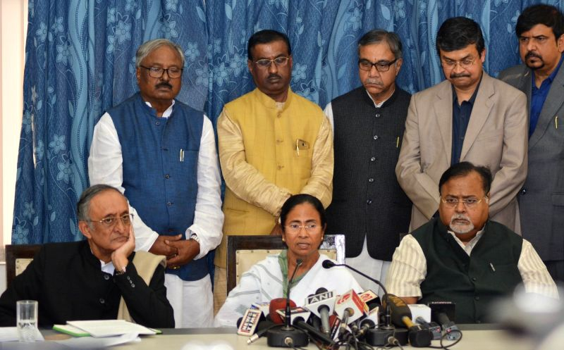 West Bengal Chief Minister Mamata Banerjee addresses a press conference at State Assembly in Kolkata on Jan 31, 2018. Also seen West Bengal Finance Minister Amit Mitra and Education minister ... - Mamata Banerjee and Partha Chatterjee