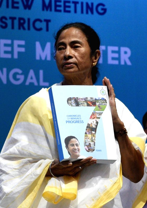 West Bengal Chief Minister Mamata Banerjee releases a book on seven years of her government during a programme in Howrah on June 7, 2018. - Mamata Banerjee