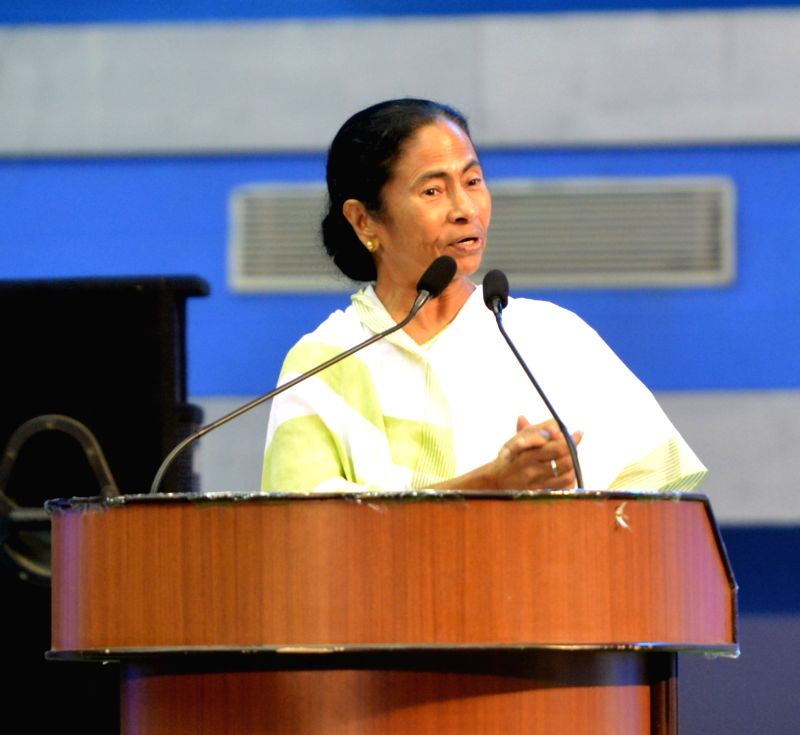 West Bengal Chief Minister Mamata Banerjee addresses during a programme organised to felicitate secondary and higher secondary exam toppers, in Kolkata on June 11, 2018. - Mamata Banerjee