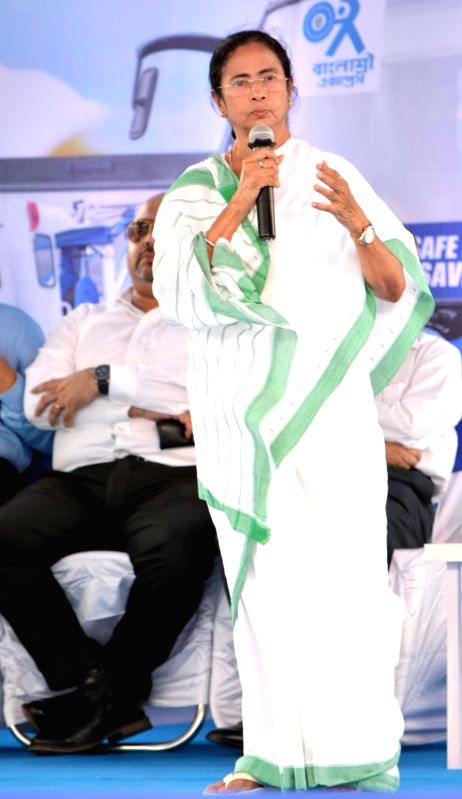 West Bengal Chief Minister Mamata Banerjee addresses during a programme organised to flag-off Trauma CareAC ambulance and Banglashree Express at Nabanna in Howrah on July 18, 2018. - Mamata Banerjee