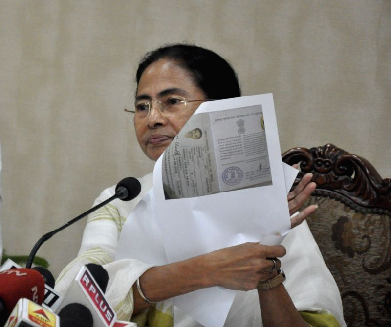 West Bengal Chief Minister Mamata Banerjee addresses a press conference at Nabanna in Howrah, West Bengal on July 30, 2018. The first complete draft of the National Register of Citizens (NRC) ... - Mamata Banerjee