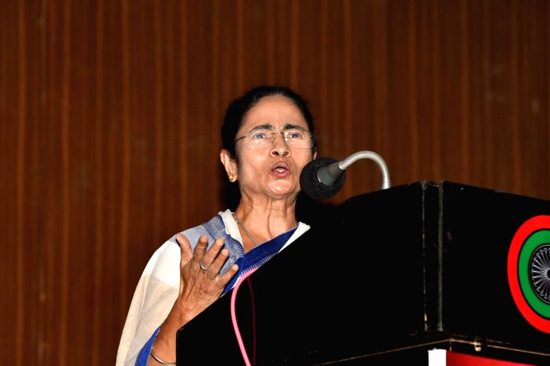 """West Bengal Chief Minister Mamata Banerjee addresses during a conference on """"Love Your Neighbour"""", in New Delhi on July 31, 2018. - Mamata Banerjee"""