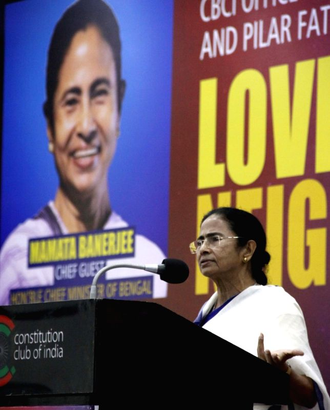 "West Bengal Chief Minister Mamata Banerjee addresses during a conference on ""Love for Neighbour"", in New Delhi on July 31, 2018. - Mamata Banerjee"