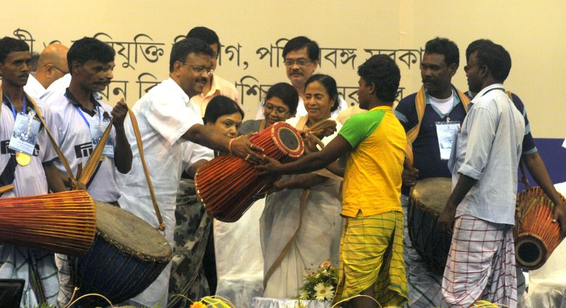 West Bengal Chief Minister Mamata Banerjee and West Bengal Urban development Minister Firhad Hakim during a programme organised on 'Hul Diwas' in Kolkata on June 30, 2014. - Mamata Banerjee