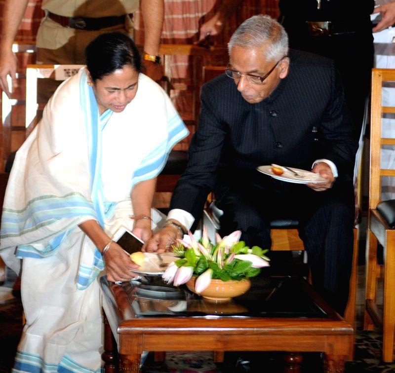 West Bengal Chief Minister Mamata Banerjee and West Bengal Governor M.K. Narayanan during a programme at Raj Bhawan in Kolkata on July 2, 2014.