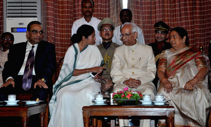 West Bengal Chief Minister Mamata Banerjee and New Governor of West Bengal Keshari Nath Tripathi with his wife during Governor's oath taking ceremony at Raj Bhawan in Kolkata on July 24, 2014. - Mamata Banerjee