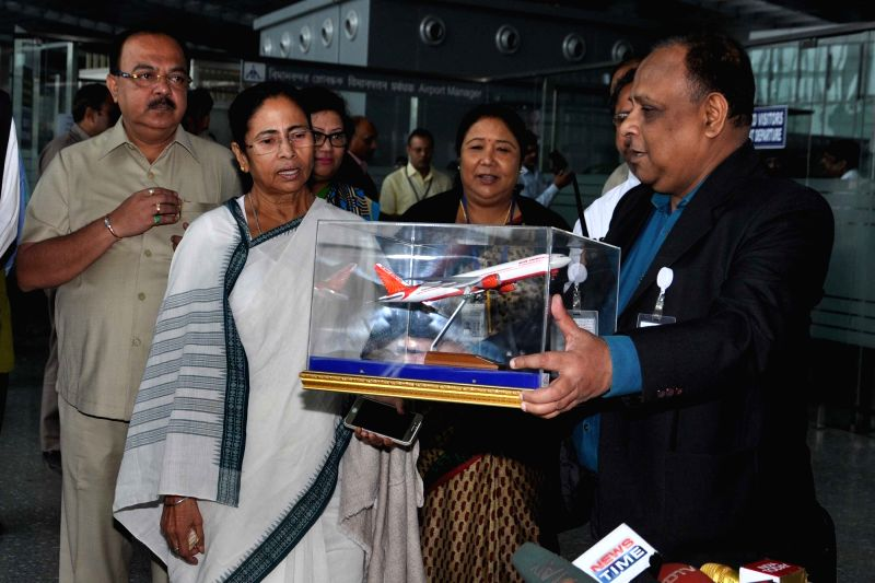 West Bengal Chief Minister Mamata Banerjee and Bengal Aerotropolis Projects Limited (BAPL) MD Partha Ghosh during a press conference at the launch of Durgapur-New Delhi direct flight at ... - Mamata Banerjee and Partha Ghosh