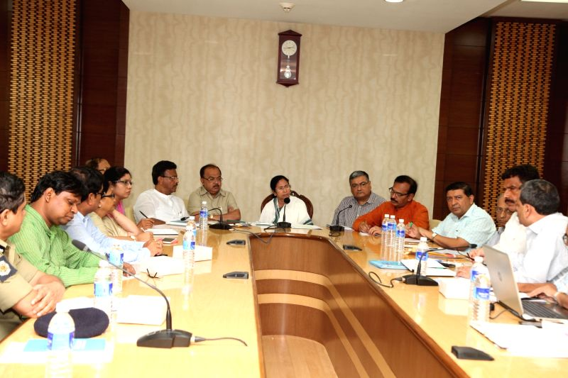 West Bengal Chief Minister Mamata Banerjee and her ministers during a meeting on 'Dengue' at Nabanno in Howrah Aug 2, 2016. - Mamata Banerjee