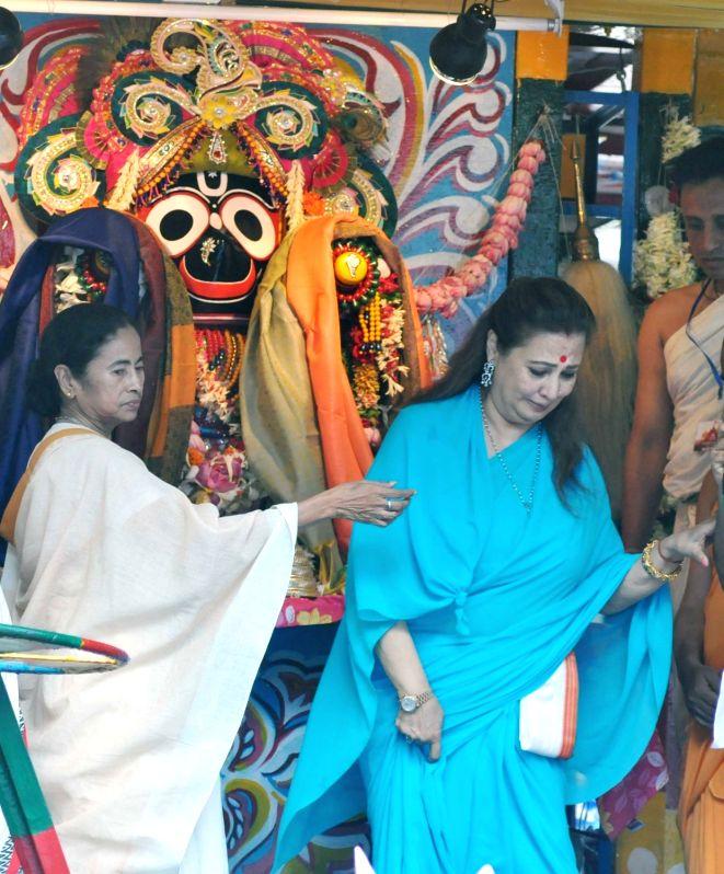 West Bengal Chief Minister Mamata Banerjee and actress Moon Moon Sen during Jagannath Rath Yatra celebrations at International Society for Krishna Consciousness (ISKCON), in Kolkata on July ... - Mamata Banerjee