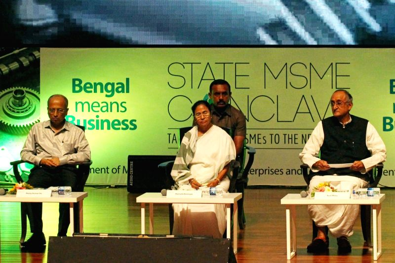 West Bengal Chief Minister Mamata Banerjee and Finance Minister Amit Mitra during the inaugural programme of State MSME Conclave, in Kolkata on Aug 20, 2018. - Mamata Banerjee
