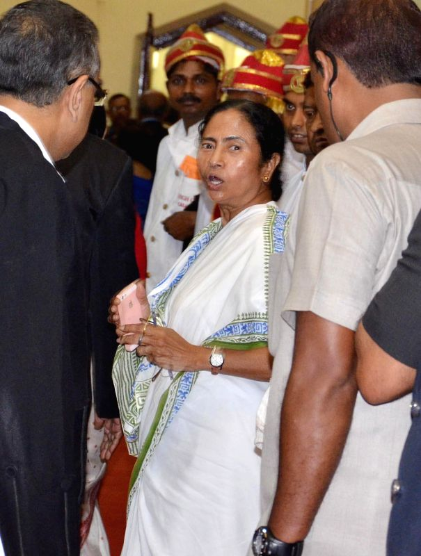 West Bengal Chief Minister Mamata Banerjee during swearing-in ceremony of newly appointed Chief Justice of Kolkata High Court Manjula Chellur in Kolkata High Court on Aug 5, 2014. - Mamata Banerjee