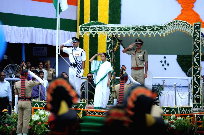 West Bengal Chief Minister Mamata Banerjee during 68th Independence Day celebrations in Kolkata on Aug 15, 2014. Also seen Kolkata Police Commissioner Surojit Kar Purokayastha.