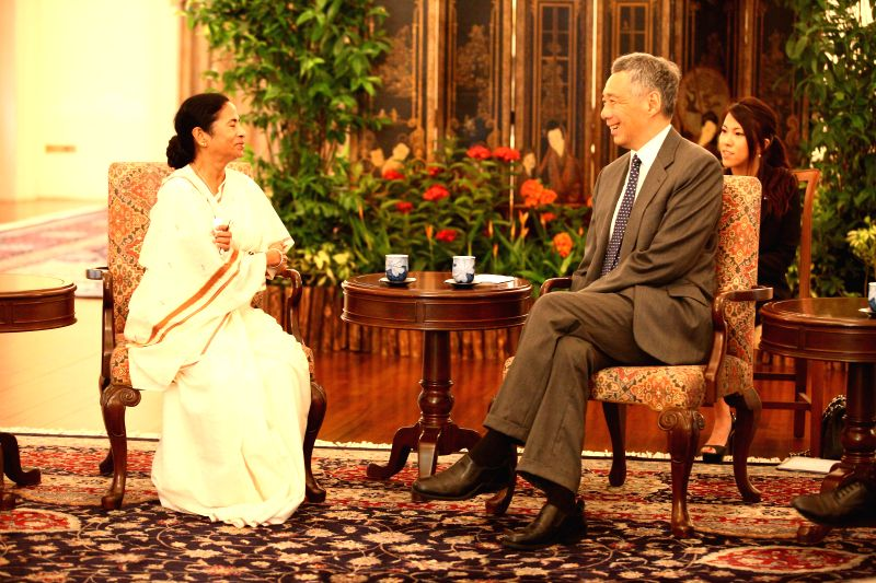 West Bengal Chief Minister Mamata Banerjee during a meeting with Prime Minister of Singapore Lee Hsien Loong in Singapore on Aug 19, 2014.