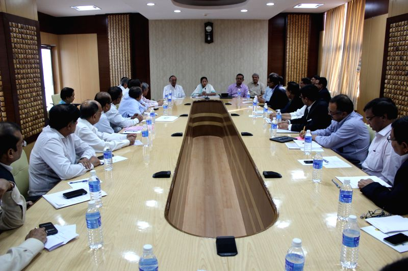West Bengal Chief Minister Mamata Banerjee  during a meeting with industrialists who went on Singapore trip with her at Nobanno in Howrah,  West Bengal on Aug 27, 2014. Also seen West Bengal Finance .