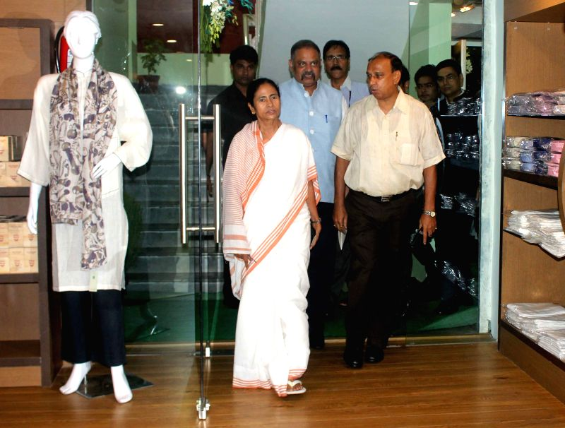 West Bengal Chief Minister Mamata Banerjee during inauguration of `Biswa Bangla` emporium in New Delhi, on Aug 11, 2015. - Mamata Banerjee