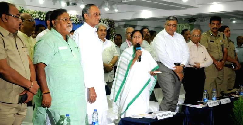 West Bengal Chief Minister Mamata Banerjee during a meeting in Kolkata, on June 3, 2016. Also seen West Bengal ministers Mukul Roy and Amit Mitra. - Mamata Banerjee and Mukul Roy