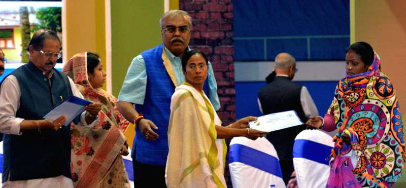 "West Bengal Chief Minister Mamata Banerjee during a programme organised to handover documents to the beneficiaries of ""Bengal Awas Yojana"" scheme in Kolkata, on Jan 29, 2018. Also ... - Mamata Banerjee and Subrata Mukherjee"