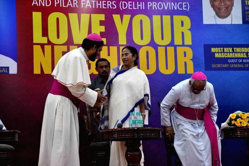 """West Bengal Chief Minister Mamata Banerjee during a conference on """"Love Your Neighbour"""", in New Delhi on July 31, 2018. - Mamata Banerjee"""