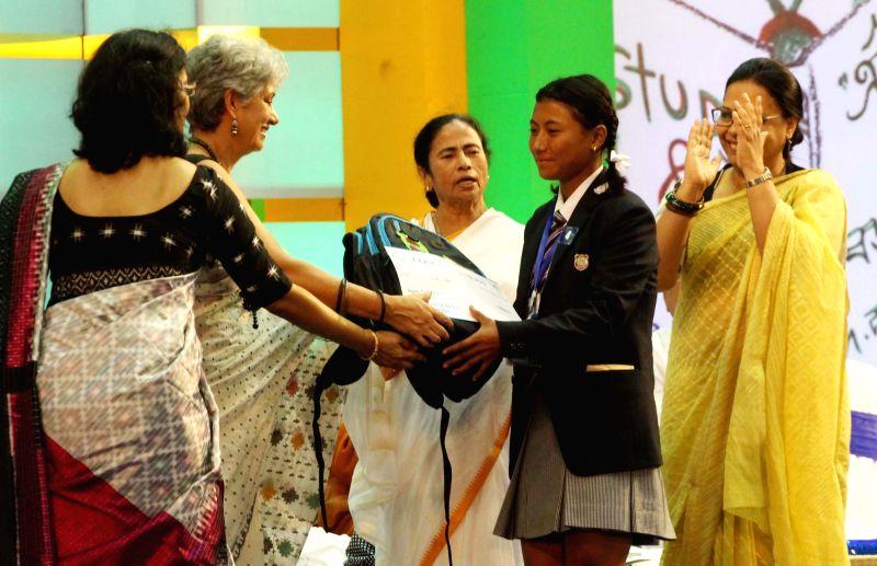 """West Bengal Chief Minister Mamata Banerjee during the 5th anniversary celebrations of """"Kanyashree Diwas"""", in Kolkata on Aug 14, 2018. - Mamata Banerjee"""
