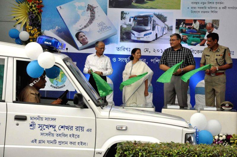 West Bengal Chief Minister Mamata Banerjee flags off ambulances at Nabanna in Howrah, near Kolkata on May 27, 2017. - Mamata Banerjee