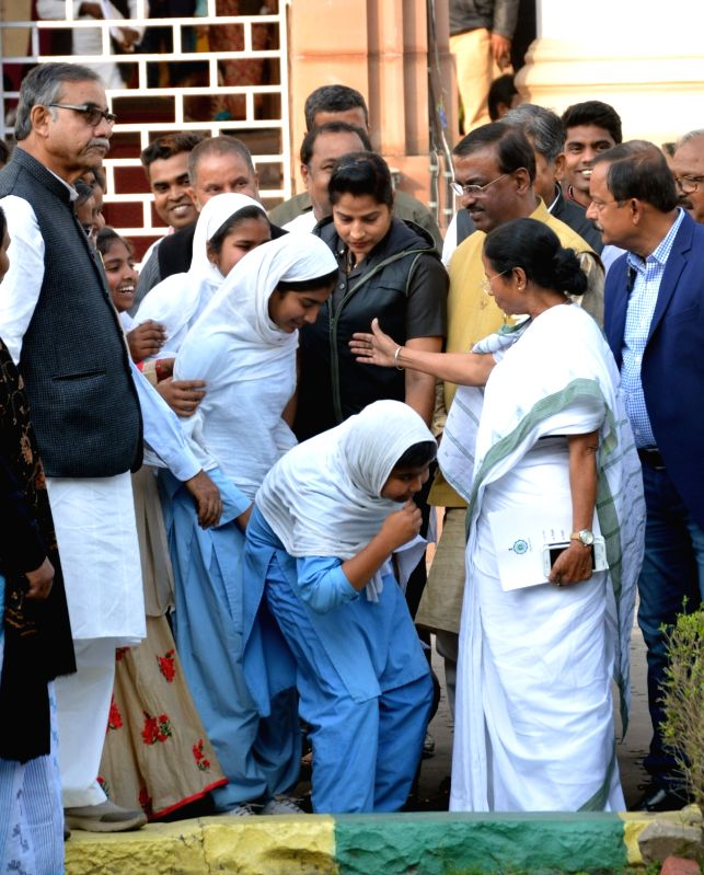 West Bengal Chief Minister Mamata Banerjee meet school students outside the State Legislative Assembly in Kolkata on Jan 31, 2018. - Mamata Banerjee