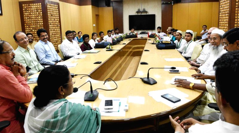 West Bengal Chief Minister Mamata Banerjee meets Madrasa Board exam toppers at Nabanna in Howrah, West Bengal on June 12, 2018. - Mamata Banerjee
