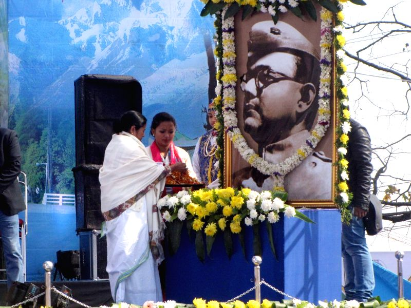 West Bengal Chief Minister Mamata Banerjee pays floral tribute at the portrait of Netaji Subhash Chandra Bose on the occasion of his birth anniversary in Darjeeling, on Jan 23, 2016.