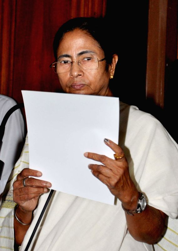 West Bengal Chief Minister Mamata Banerjee takes oath as a legislator at the West Bengal Assembly in Kolkata, on May 28, 2016. - Mamata Banerjee