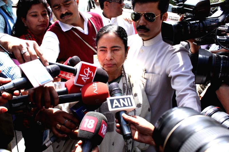 West Bengal Chief Minister Mamata Banerjee talks to media persons at the Parliament in New Delhi, on March 9, 2015.