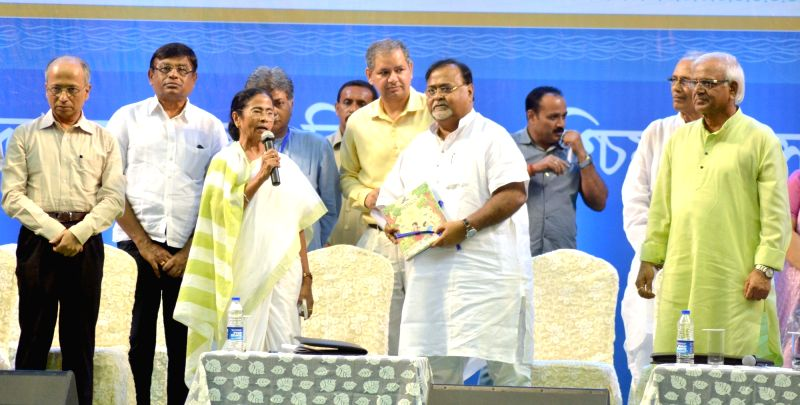West Bengal Chief Minister Mamata Banerjee, the state's Education Minister Partha Chatterjee and other dignitaries during a programme organised to felicitate secondary and higher secondary ... - Mamata Banerjee and Partha Chatterjee