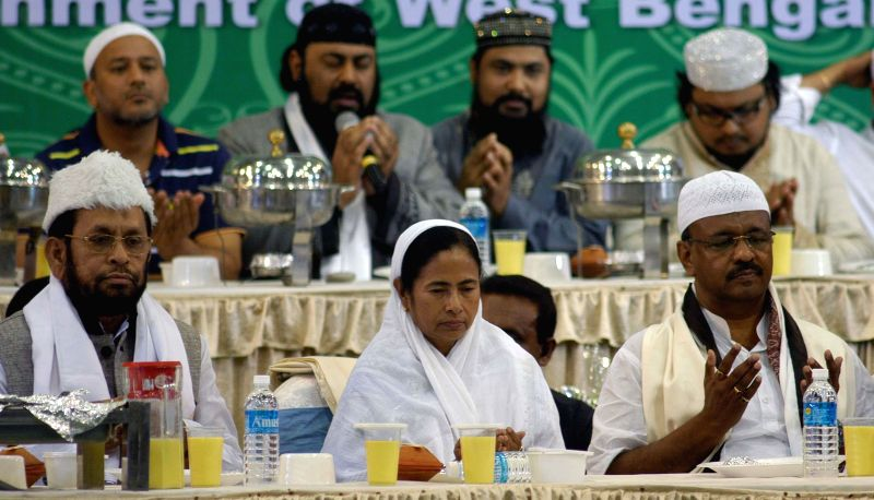 West Bengal Chief Minister Mamata Banerjee, Urban development Minister Firhad Hakim during an iftaar party organised by Mohammedan Sporting Club in Kolkata on July 28, 2014. - Mamata Banerjee