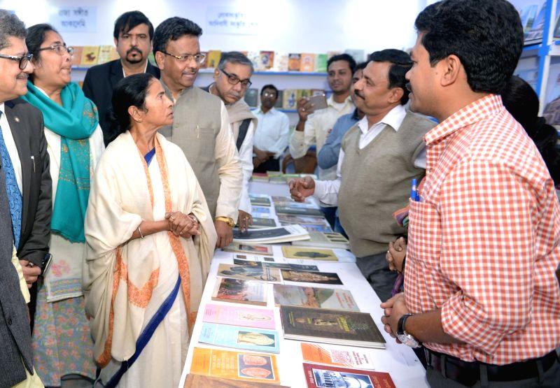 West Bengal Chief Minister Mamata Banerjee visits book stalls after inaugurating the 42nd International Kolkata Book Fair 2018 in Kolkata on Jan 30, 2018. - Mamata Banerjee