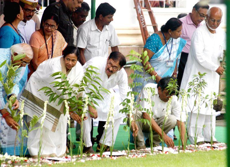 West Bengal Chief Minister Mamata Banerjee, West Bengal Legislative Assembly Speaker Biman Banerjee, and Leader of Opposition in West Bengal Legislative Assembly Suryakanta Mishra plant trees at West - Mamata Banerjee and Biman Banerjee